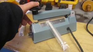 Heat impulse sealer is used to waterproof mezuzos.